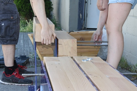 Team from Maker Labs installing the bench outside Liquids and Solids.