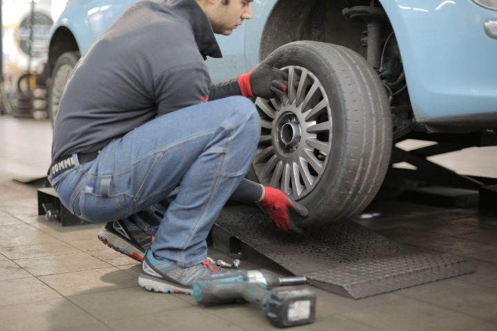 Mechanic changing a tire on a car
